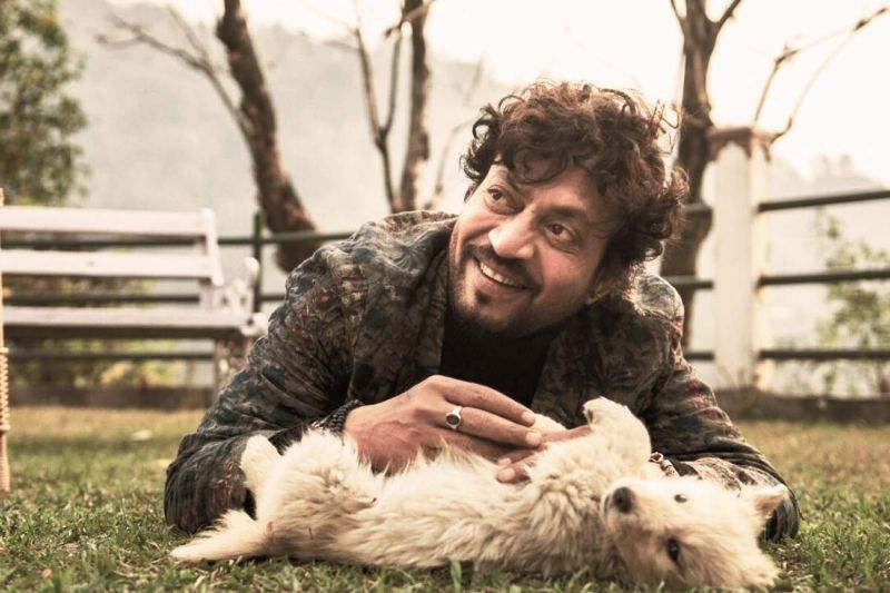 Irrfan Khan Playing With a Dog
